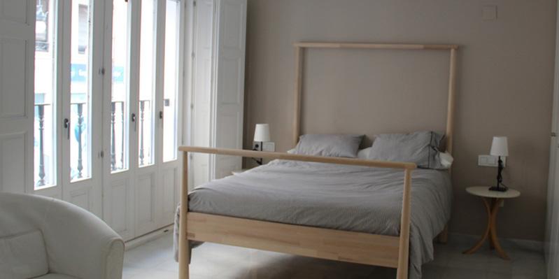 Slaapkamer in een studio-appartement